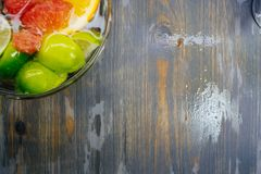 Citrus in water with bubbles in transparent plate Oranges, lemons, greyfrut royalty free stock photos