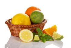 Citrus in wicker basket Stock Photography