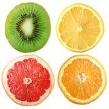 Citruses. Cuts of lemon, orange, grapefruit and kiwi are on a white background Stock Photos
