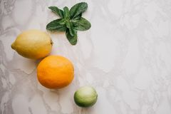 Citruses or fruits lie on the table. Mix of lemon, lime and orange.  stock image