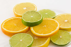 Citruses: lime, lemon and orange. On white background Stock Photos