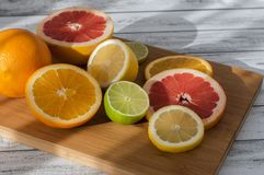 Citruses on a wooden board Royalty Free Stock Photos