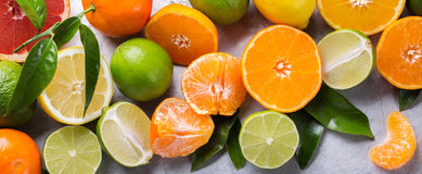 Citrusfruktbakgrund Apelsin grapefrukt, tangerin, limefrukt, citron arkivfoton
