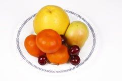 Citrusvruchten op de plaat Royalty-vrije Stock Afbeeldingen