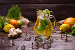 Citrusy lemonade in jug with ice. Stock Photos