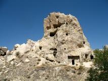 Città antica della caverna in Goreme, Cappadocia, Turchia Fotografia Stock