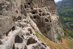 Città antica della caverna in scogliera, scavi storici Immagini Stock Libere da Diritti