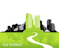 Città con erba verde. Immagine Stock