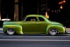 Città di lusso verde del coupé della Plymouth Fotografie Stock
