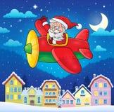 Città di Natale con Santa Claus in aereo Immagini Stock