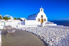Città di OIA, isola di Santorini, Grecia al tramonto Tradizionale e fa Immagini Stock Libere da Diritti