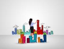 Città e costruzione del disegno della donna di affari Fotografia Stock Libera da Diritti