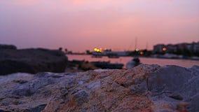 Città sotto il cielo rosa Immagine Stock