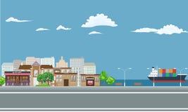 Città sul paesaggio della spiaggia con la nave da carico sul mare illustrazione di stock