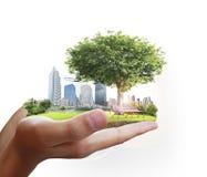 Città umana della tenuta della mano Immagini Stock Libere da Diritti