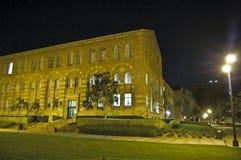 Città universitaria del banco alla notte Fotografie Stock