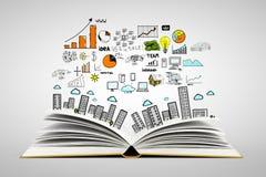 Città del disegno sopra il libro Immagini Stock