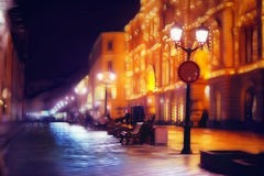 City ​​pedestrian street night city lights. Blur Stock Photos