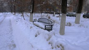 City square in winter after snow removal. the shop is littered with snow. stock photo