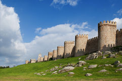 City walls of Avila, with a green garden Royalty Free Stock Photo
