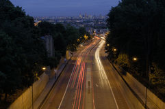 Into the City. Night shot with traffic trails of road leading in to the city. The city is London UK which can be seen on the horizon Royalty Free Stock Image