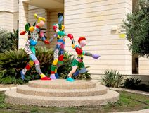 City abstract sculpture from multi-colored materials, depicting a family on a sports vacation. Located in Holon.  royalty free stock photo