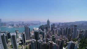 City Aerial 4K Hong Kong. 4K Aerial shot of general Hong Kong covering Hong Kong Island, Kowloon and Victory Harbour. Stunning pan shot to left with many stock video footage