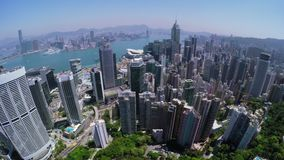 City Aerial 4K Hong Kong. 4K Aerial shot of general Hong Kong covering Hong Kong Island, Kowloon and Victory Harbour. Stunning pan shot to left with many stock footage