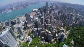 City Aerial 4K Hong Kong. 4K Aerial shot of general Hong Kong covering Hong Kong Island, Kowloon and Victory Harbour. Stunning tilt up city shot with many stock video footage