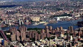 City Aerial with River, Urban, Neighborhoods, District. Stock video of a city aerial with a river. New York City, Manhattan stock footage