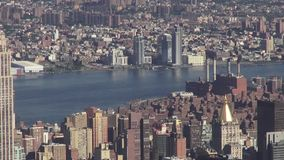 City Aerial with River, Urban, Neighborhoods, District. Stock video of a city aerial with a river. New York City, Manhattan stock video