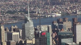 City Aerial with River, Urban, Neighborhoods, District. Stock video of a city aerial with a river. New York City, Manhattan stock video footage