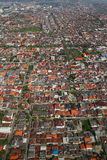 City Aerial View. A crowded city, low rise housing seen from the a aircraft Royalty Free Stock Photography