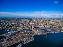 City aerial view over Amsterdam. The Netherlands. View from the bird`s flight Stock Photos