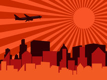 City, aeroplane and sun Royalty Free Stock Photo