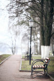 City alley autumn bench loneliness Royalty Free Stock Image