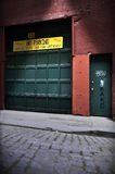 City alley parking garage. Closed parking garage doors on a city alley or narrow street Royalty Free Stock Photo