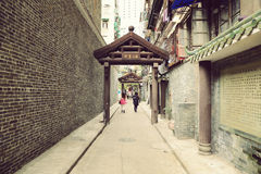 Alley. Old city alley or passageway. Small city road and urban street view with memorial archway in Guangzhou China Stock Image