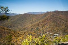 City Amongst Fall Folliage Birds Eye view. Colorful Fall Folliage in North Carolina Mountains. Autumn trees with brightly colored leaves stock image