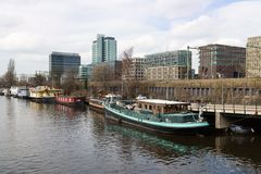 City of Amsterdam with office buildings and houseboats Royalty Free Stock Photos