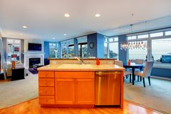 City apartment interior with orange wood kitchen w Stock Image