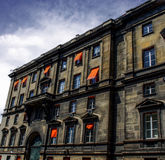City apartments in Paris, with cheerful orange blinds / shades. The picture of residential Paris depicts a strong contrast of old stone and brickwork alongside Royalty Free Stock Images