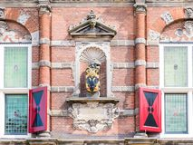 Front detail of town hall in Bolsward, Friesland, Netherlands. City arms on facade of town hall in historic old town of Bolsward, Friesland, Netherlands Royalty Free Stock Photography