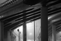 City art. Road bridge in fog with lights Stock Images