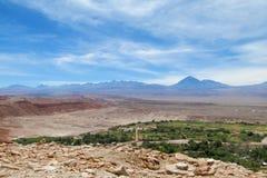 City in Atacama desert. City in desert Atacama, Chile. Green oasis at the bottomof huge volcano Stock Image