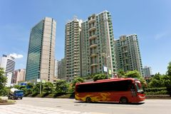 City avenue. Red auto-bus running in the city avenue,Canton,China Stock Image