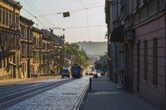 City Awaking from Sleep. LVIV, UKRAINE - MAY 25, 2018: streetcar moving throught city street in early morning in Lviv, Ukraine stock image