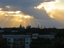 City background with a grandiose sunset. The capital of Latvia is Riga and a grandiose sunset. Evening view of clouds and sunset Royalty Free Stock Image