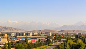 City on background of the mountains of Tien Shan Stock Images