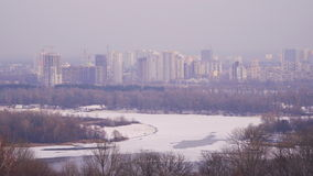 The city is on the bank of a frozen river stock video footage